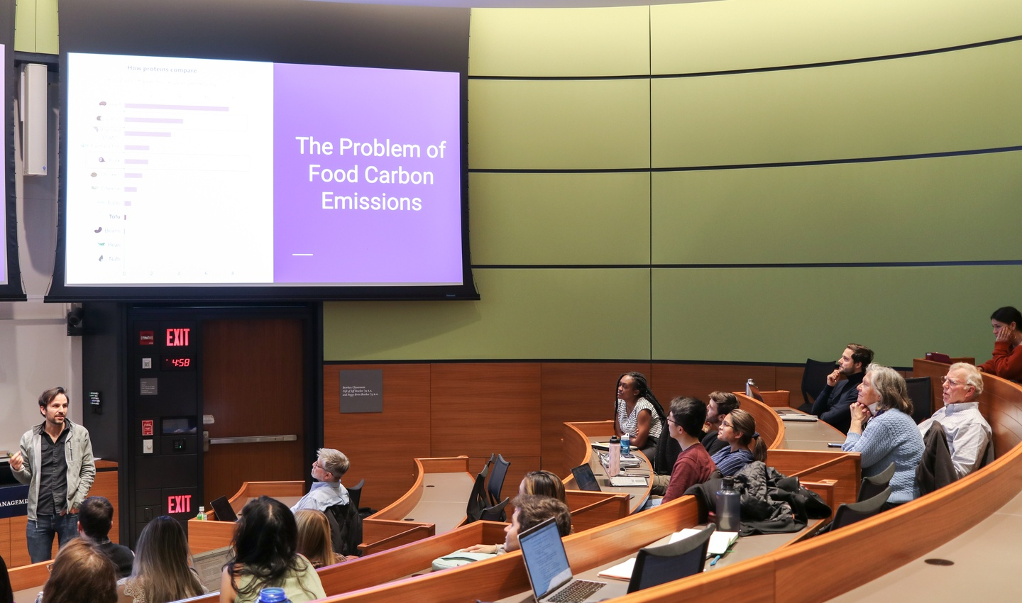 Students present on food carbon emissions in lecture hall
