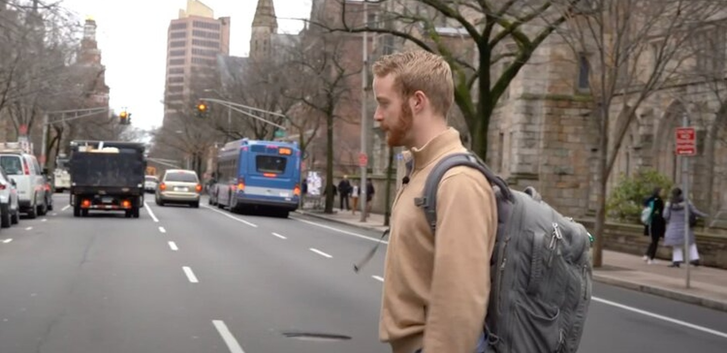 Ben Christensen walks across street in video screenshot