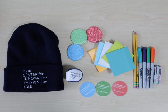 Flatlay image of Tsai CITY swag and office supplies