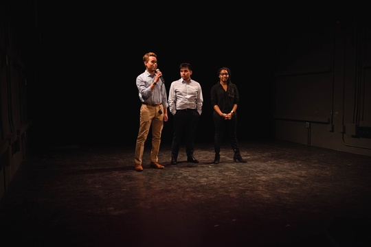 Three students pitch idea onstage