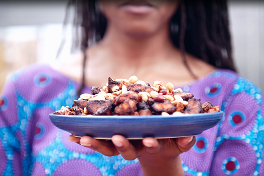 Image of person holding plate of plantains